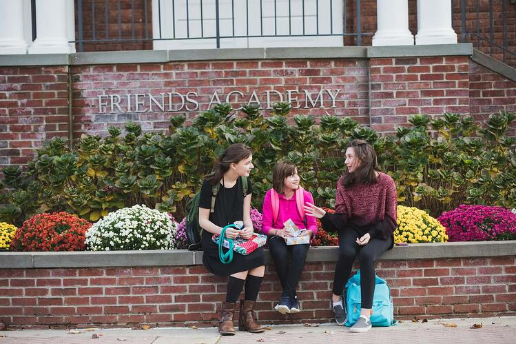 middle school girls seated on campus