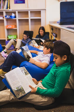 lower-school-students-reading-library