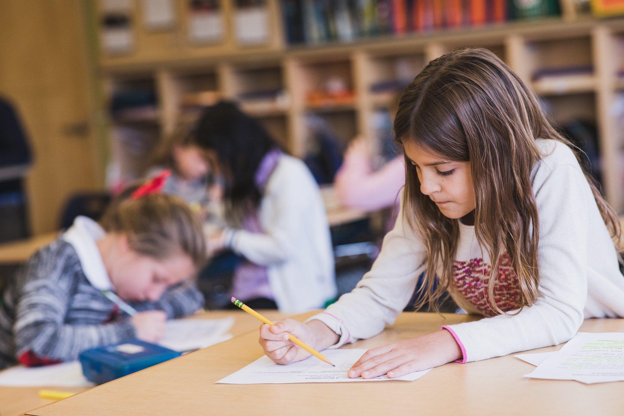 lower school writing in classroom