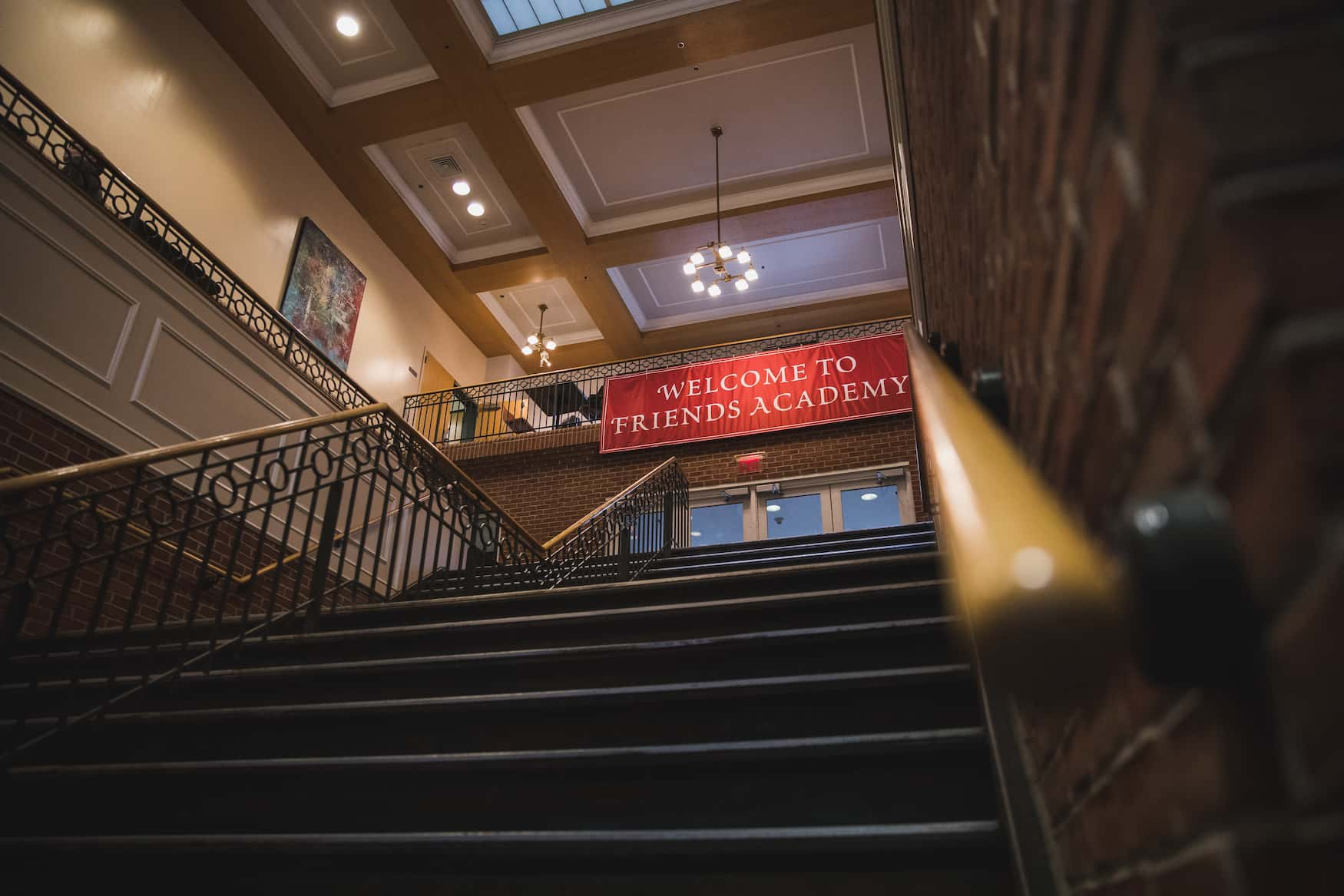 staircase with friends academy banner