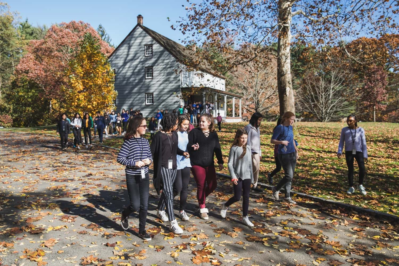 students walking thru friends academy campus